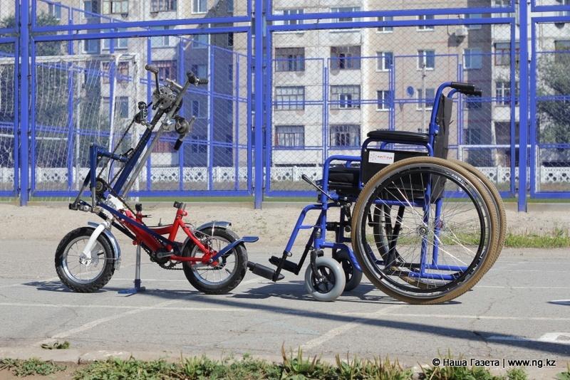 Гибрид велосипеда и инвалидной коляски