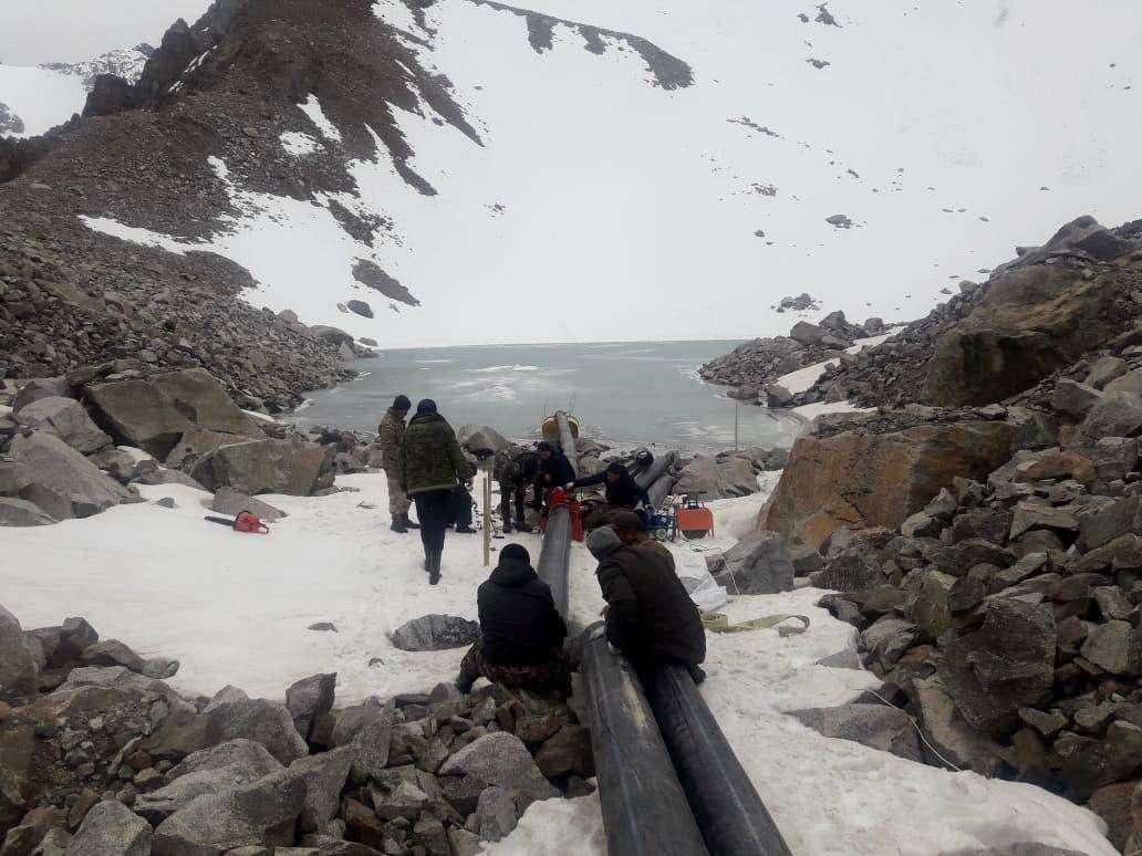 Работы по сбросу воды с озёр в горах алматы