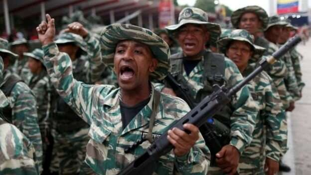 В рядах Национальной боливарианской милиции - убежденные сторонники политики Уго Чавеса и его преемника - Николаса Мадуро